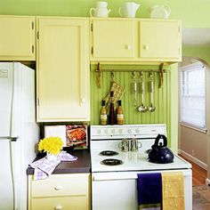 yellow cabinets with dark counter tops thanks @Kate Harris