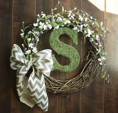 Moss Covered Monogrammed Grapevine Wreath with white flower details intertwined  a Chevron Burlap Bow via Etsy