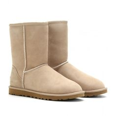 UGG Australia Classic Short Boots ($337) ❤ liked on Polyvore featuring shoes, boots, ankle booties, uggs, buty, sand, round toe boots, shearling lined boots, ankle boots and bootie boots