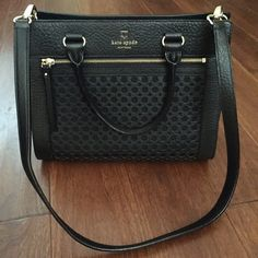 Kate Spade Perri Lane Romy Handbag Brand new and authentic Kate spade handbag with black pebbled leather and perforated front panel. Cross body strap is adjustable and removable. Lots of compartments. kate spade Bags Shoulder Bags