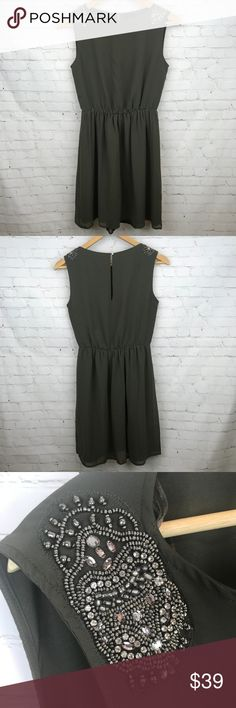 """Zara Trafaluc Olive Dress Embellished Sheath Dress Zara Trafaluc Olive Dress Embellished Sheath Dress Wear it to brunch or out on a date, wherever you go, you'll love your look. Featuring embellished sleeves, this sheath dress can be worn on its own, with a leather jacket thrown on top or paired with tights & boots. Approximate measurements waist 12"""", sleeve 2.75"""", pit to hem 25"""", waist to hem 18"""", length 32"""". Preowned from a smoke free home in great used condition. Check out the rest of my…"""