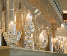 White candles in unique hurricanes are luxurious with oversized gems.
