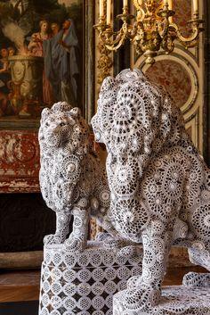 2012 Joana Vasconcelos exhibits her art at the Chateau de Versailles, Salles des Gardes de la Reine. Her show is an homage to the 'Rocker Queen' Marie Antoinette of France - Lions tamed in Lace
