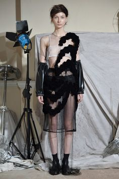 Leather arm cuffs and net dress at the Phoebe English AW15 Presentation LFW. See more here: http://www.dazeddigital.com/fashion/article/23770/1/phoebe-english-aw15