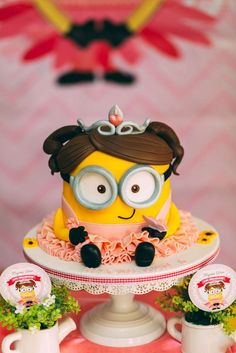 Incredible cake at a girly Minion birthday party! See more party planning ideas at CatchMyParty.com!