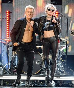 Battle of the bellys! Billy Idol and Miley Cyrus flaunted their respective six-pack abs while performing together at the iHeartRadio Music Festival in Las Vegas on Friday Rock Chic, Glam Rock, Rihanna Work, Lauren Bushnell, Jojo Fletcher, Laurie Hernandez, Miley Cyrus Style, Rebel Yell, Zoolander