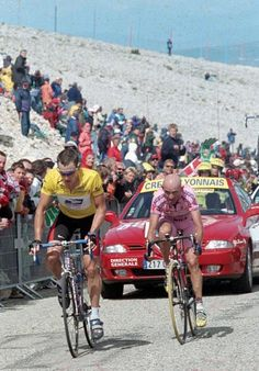Race leader Lance Armstrong and Marco Pantani approach the Mont Ventoux summit finish in the 2000 Tour de France.