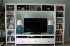 Upgraded Entertainment Center- ikea hemnes tv stand and media towers with the bridge inbetween. A great low cost option for a white media center for a flat screen and tons of storage!