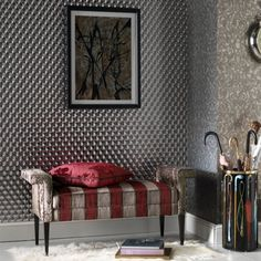 The bold, striking Rombico is a geometric, hologram, wallpaper that makes a big visual statement in any room. It features repeating, reflective diamonds in a clear metallic effect, and the hologram pattern causes light reflections to produce wonderful optical illusions. This outstanding, dazzling design is the ideal choice for a feature wall and would suit an ultra-modern interior.