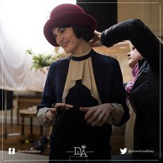 Costume adjustments on set of Series 5 of Downton Abbey. Follow us on Instagram for more behind the scenes photos! http://instagram.com/downtonabbey_official