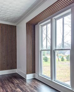 Ever since the first time I saw a slat wall, I couldn't wait to add one to my home! I have seen many different styles (plain wood against a white wall, painted wood on a painted wall…) … Wood Slat Wall, Wood Slats, Modern Wall Paneling, Panelling, Condo Living, Living Rooms, Wall Treatments, White Walls, Bedroom Wall
