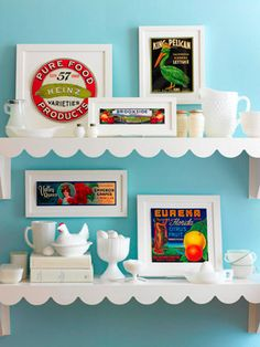 Vintage Labels -  The vibrant colors of vintage fruit and vegetable crate labels create make a bold statement when they are grouped together. Displayed amidst a sea of white accessories, atop white scalloped shelves, the graphic labels pop and create the perfect retro cottage display. (bhg.com)