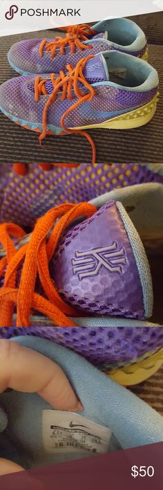 Kyrie Irving 1's Youth size purple blue yellow. Amazing shoes. I don't notice any tears but yellow nobbies has dirt.strings r a little worn. Little wearing on right shoe left side where u slide foot in. kyrie irving shoes  Shoes Sneakers