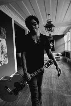 Lenny Kravitz---I don't know who he is, but he looks awesome! :)
