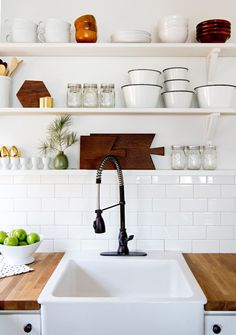 Embrace open shelf storage in your tiny kitchen and other tips to make your kitchen seem larger.