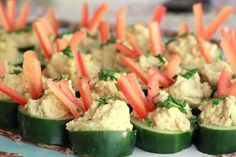 Cucumber hummus cups - super easy and delicious. Used cilantro, jalepeno humus and roasted red pepper humus Healthy Appetizers, Appetizers For Party, Appetizer Recipes, Healthy Snacks, Healthy Eating, Healthy Recipes, Eating Clean, Party Recipes, Healthy Options