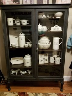 My Rae Dunn collection so far in an antique china cabinet circa 1910s.