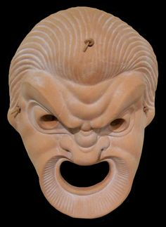 Replica 3rd century Greek comedic theatrical mask - http://www.usask.ca/antiquities/images/collection/hellenistic/maskclaycomic.jpg