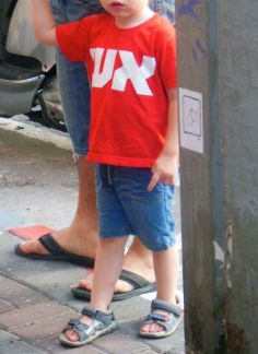 """When you are looking at graffiti you start to notice t-shirts, too! I think this little boy's t-shirt says """"fire"""" in Hebrew! Photo by Roman Mysteries author Caroline Lawrence. Friday 20 June 2014"""