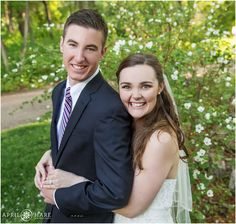 Cute wedding portrait with white spring blossoms at Denver Botanic Gardens Chatfield Farms in Colorado. - April O'Hare Photography http://www.apriloharephotography.com