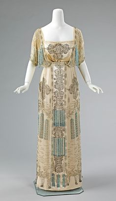 "French evening dress (1909-11) made of silk and rhinestones  Description: ""This dress is a tour de force of beadwork embroidery, indicative of French couture craftsmanship. The juxtaposition of three-dimensional and trompe l'oeil tassels is stylish and witty, and highlights the level of planning and care taken in the design of couture garments."""