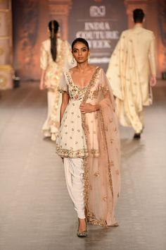 White embroidered Shyamal Bhumika Kurta Dhoti set Shyamal Bhumika ICW 2018 collection consisted of some stunning bridal lehengas, grooms wear sherwanis, tons of wedding guest outfits and loads of Indian Wear designs. Every year, Shyamal & Bhumika… Indian Wedding Outfits, Pakistani Outfits, Indian Outfits, Lehenga, Anarkali, Saree, Indian Designer Suits, Designer Kurtis, Couture Week