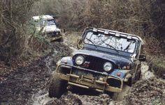 A Jeep 4x4 on a muddy trail.