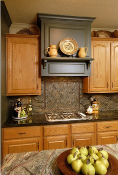 Stunning counter on island , gorgeous backsplash...Ideas to update oak cabinets with a bit of paint