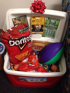 Cool gift idea for him. Cooler with snacks, drinks, nerf football and movie, lottery or game tickets.