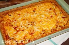 Hot Pintos and Cheese Dip (Texas Trash) - made from refried beans and onions, sour cream, cream cheese, taco seasoning, red sauce and both pepper jack and cheddar cheeses.