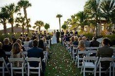 Wedding overlooking Gulf of Mexico at the Ritz Carlton Beach Club on Lido Key.