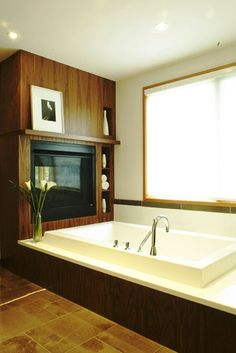 interesting walnut tub surround & shelves