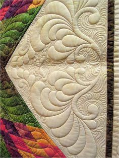 Love the quilting - especially the added interest of the butterfly and background movement. - NJ