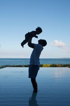 Jay Z Holds Up Blue Ivy During A Pool Paddle