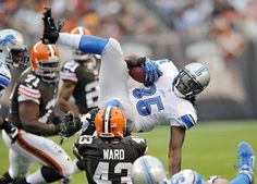 Best of NFL Week 6  --  Detroit Lions running back Joique Bell (35) is tripped up by Cleveland Browns strong safety T.J. Ward (43) after an 8-yard gain in the first quarter of an NFL football game Sunday, Oct. 13, 2013 in Cleveland. (AP Photo/David Richard)