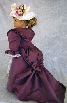 Victorian Walking Suit for AG. Dusty plum Silk Dupioni Shawl Collar Jacket and Skirt are fully lined, ivory Silk Dupioni long sleeved blouse has pintucked bodice with lace and rosette trim at front and neckline. Gored a-line skirt has sweep train and bustle with silk bow at bustle back. Hat, slip, bloomers & parasol complete the ensemble, by alterations24u via eBay, SOLD 7/20/14 $280.00