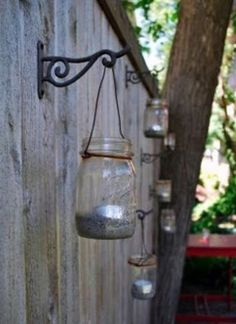 diy mason jar + candle + wire + wrought iron hook - would love to turn into solar candles