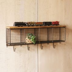 Make a statement right in your entryway with this storage system. The Wire Cubbies and Wood Shelf come with bag and coat hooks and plenty of storage space for books, bags, and everything else that come... Find the Wire Cubbies With Wood Shelf, as seen in the 24 Hour Clearance Sale: Day 2 Collection at http://dotandbo.com/collections/presidents-day-weekend-sale-2016-decor-clearance-day-2?utm_source=pinterest&utm_medium=organic&db_sku=KLL0058