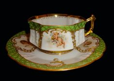 """Antique Dresden Ambrosius Lamm Porcelain Cup & Saucer. Marked Dresden Lamm Mark. Hand Painted Angel On Green Background with gold gilt. The saucer measures 5 1/2"""" in diameter. The set is in excellent condition, no chips, crack or crazing. 
