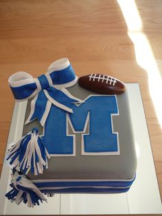I made a replica of the big M logo of their school. I used blue luster dust to shine the M and the bow. The chocolate cake filled with ganache than covered with fondant was placed on a mirror. All details are fondant. 10 Birthday Cake, Kylie Birthday, Cakes For Teenagers, Cakes For Boys, Cheerleading Cake, Cheerleader Cakes, Fondant Cakes, Cupcake Cakes, Cupcakes