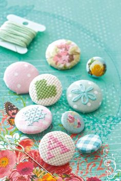 Covered buttons tutorial with charts for the cross stitch ones.. Love the heart cross stitch button.