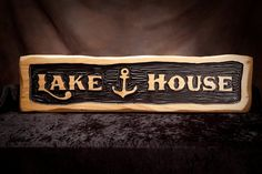 """This is a custom relief carved sign featuring my log edge profile and  a relief carved background finished with a special industrial ink that will never fade. The carved background mimics waves in a lake and enhances the bold western lettering. This quality sign is made of 1.5"""" thick premium he..."""