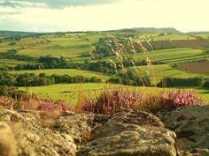 The lovely Summer sun shining over the hills and lighting up corby crags