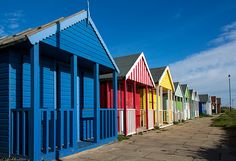 Beach Huts at Sutton on Sea, Traditionally painted in bright colours, beach huts are a very cheery addition to an English seaside town Seaside Uk, British Seaside, Seaside Towns, British Isles, Beach Huts, Deck Chairs, Bright Colours, Small Houses, Cabins
