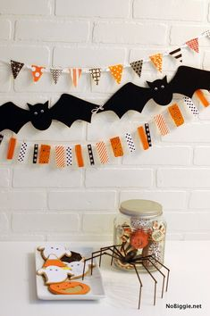 Halloween garland how-to - NoBiggie.net Use all that great scrapbooking paper!