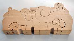 Close up of 6-piece wooden Hundefamilie, or Dog Family, puzzle (no. 9232), designed by Sabu Oguro, Switzerland, 1980-83, by Naef Spiele.