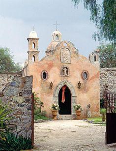 AN OLD STORAGE BUILDING WAS CONVERTED INTO A VILLA IN HACIENDA STYLE