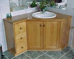 corner vanity with side drawers would help use up wasted space on wall opposite window...