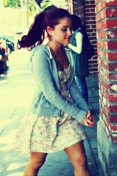 I love how ariana rocked this style of a cute dress but with a pony tail and sweat jacket to make it casual.. So cute