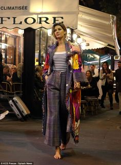 She can pull off anything: Gisele then swapped her monochrome attire for a flashy, multi-c...